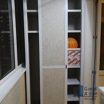 двухстворчатый шкаф белого цвета
