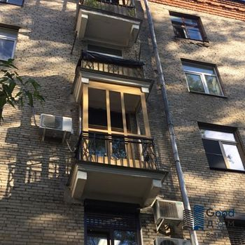 Частичная отделка ПВХ и остекление старого балкона